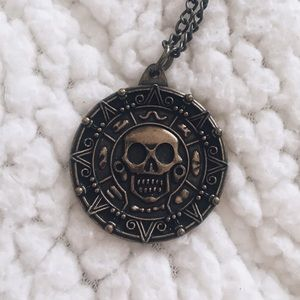Jewelry - Disney Pirates of the Caribbean Cursed Coin
